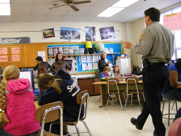 Police Officer in Student Classroom